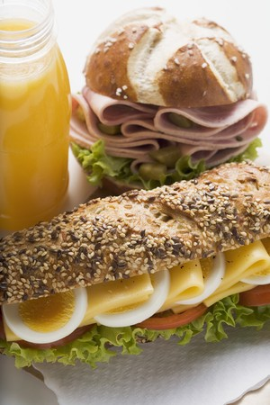 lye: Cheese sandwich, sausage in lye roll and fruit juice LANG_EVOIMAGES