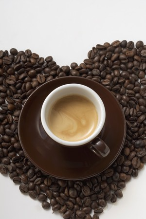 solo form: A cup of coffee on a heart of coffee beans