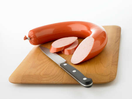scalded sausage: Ring bologna, partly sliced LANG_EVOIMAGES