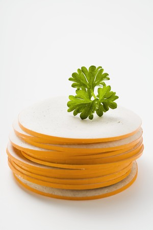 veal sausage: Slices of Gelbwurst (pork & veal sausage) in a pile with parsley