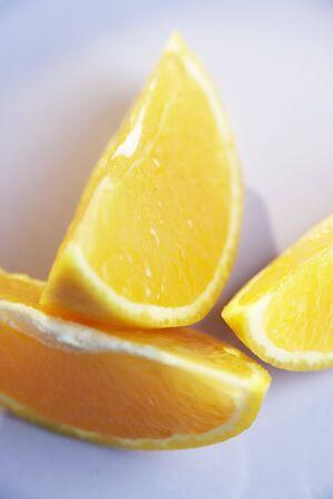 quartered: Three orange wedges LANG_EVOIMAGES