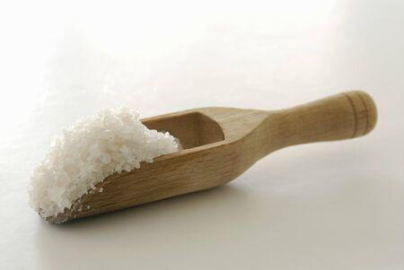 wooden scoop: Coarse sea salt in a wooden scoop
