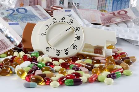 non cash: Picture symbolising Diabetes (Money, tablets, insulin syringe)