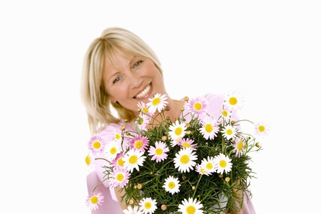 marguerites: Cheerful woman holding bouquet of marguerites in her hands
