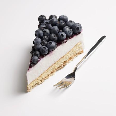 cream cake: A piece of blueberry cream cake
