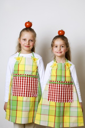 5 10 year old girl: Two girls with tomatoes on their heads
