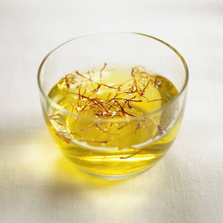 dissolved: Saffron threads in a small bowl of water LANG_EVOIMAGES