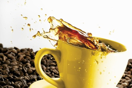 no movement: Coffee spilling out of a cup