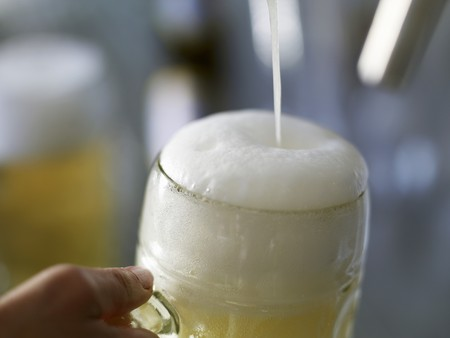near beer: Pouring a litre of shandy LANG_EVOIMAGES