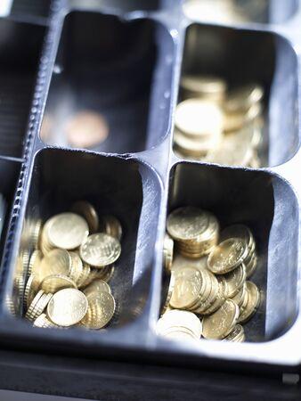 Coins in an open till LANG_EVOIMAGES
