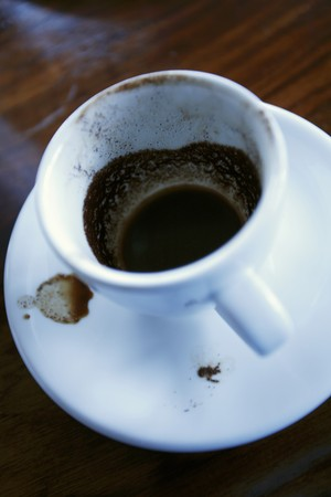 Coffee dregs in a cup LANG_EVOIMAGES
