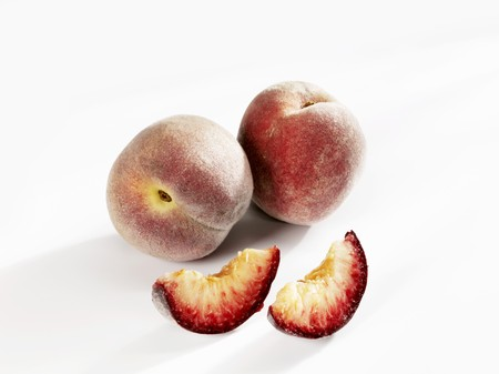 in twos: Vineyard peaches, two whole peaches and two pieces