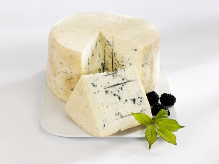 brambleberries: A blue cheese with a piece cut and blackberries LANG_EVOIMAGES