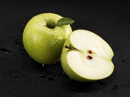 granny smith apple: Whole and half Granny Smith apple