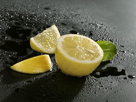 two and a half: Half a lemon and two lemon wedges LANG_EVOIMAGES
