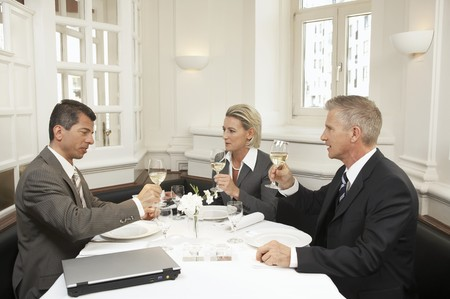 Three business people eating a meal together LANG_EVOIMAGES