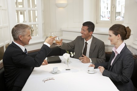 35 to 40 year olds: Three business people after a successful day