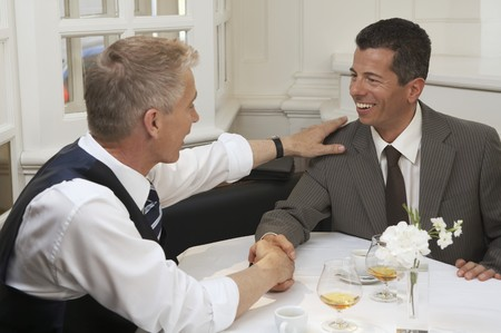 conviviality: Two businessmen after a successful deal