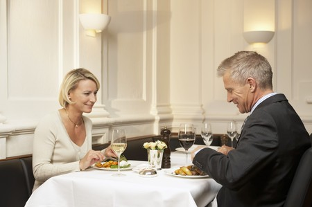 35 to 40 year olds: Man and woman eating together in a restaurant