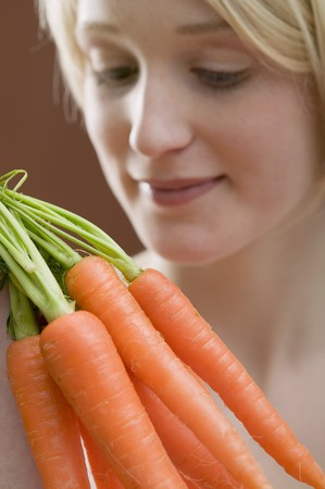 well beings: Young woman with carrots