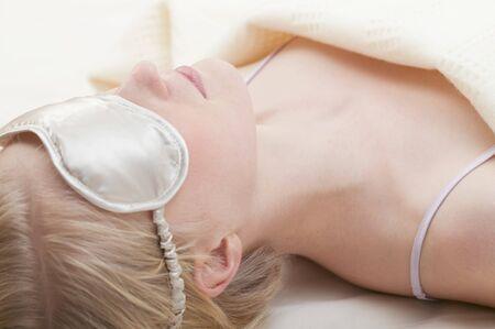 sleep mask: Young woman with sleep mask LANG_EVOIMAGES