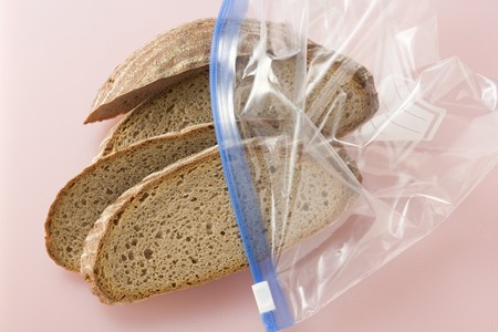several breads: Four slices of mixed wheat and rye bread in a plastic bag