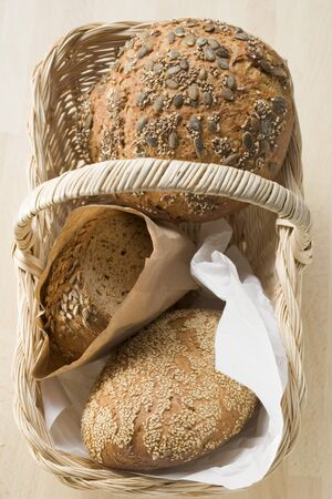 several breads: Three different types of bread in bread basket