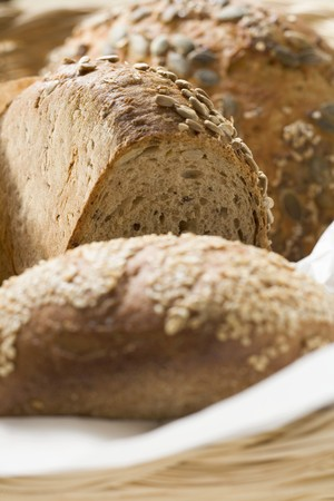 several breads: Three different loaves of bread in bread basket LANG_EVOIMAGES