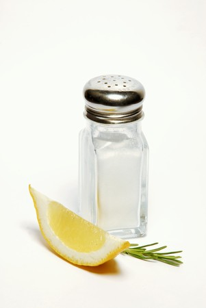 lemon wedge: Salt shaker with rosemary and lemon wedge