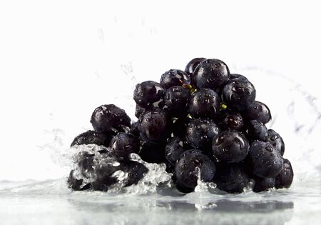no movement: Red grapes in water
