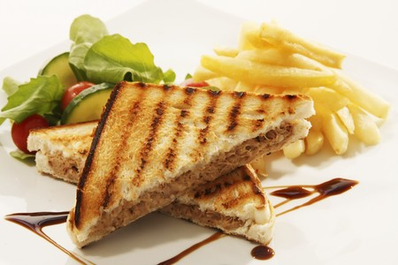 substantial: Toasted tuna sandwich with chips