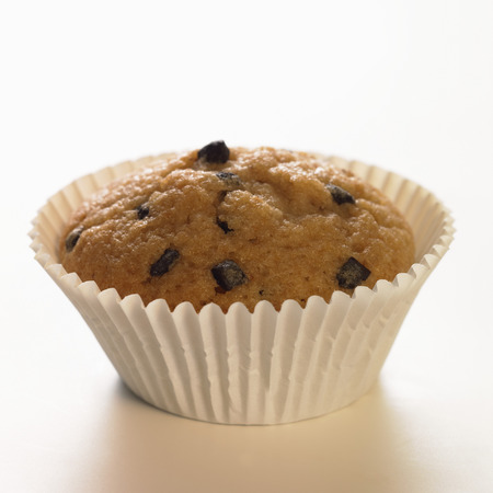 a frill: Chocolate chip muffin in paper case LANG_EVOIMAGES