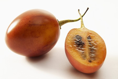 tamarillo: Tamarillo, whole and half