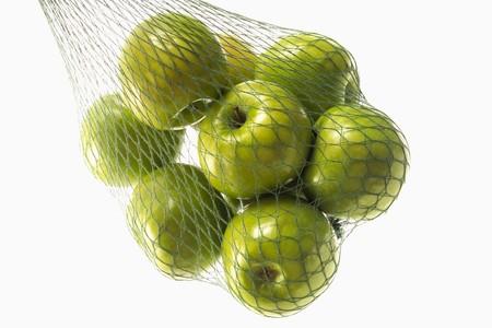 granny smith: Granny Smith apples in green string bag