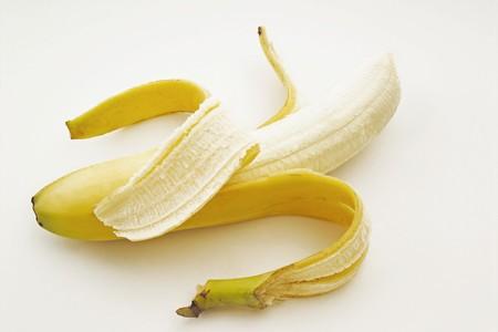 peeled banana: One Partially Peeled Banana