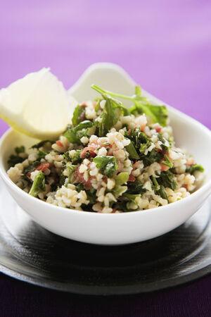 pearl barley: Pearl barley salad with parsley in a bowl
