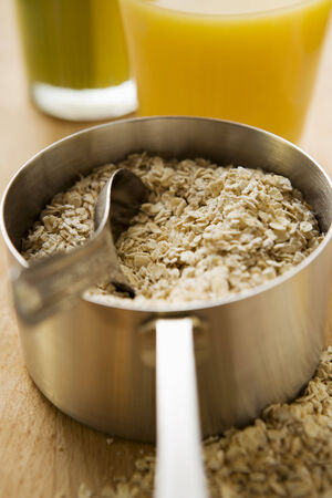 rolled oats: Rolled oats in a pan
