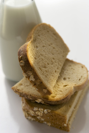 several breads: Slices of bread leaning against a milk bottle LANG_EVOIMAGES