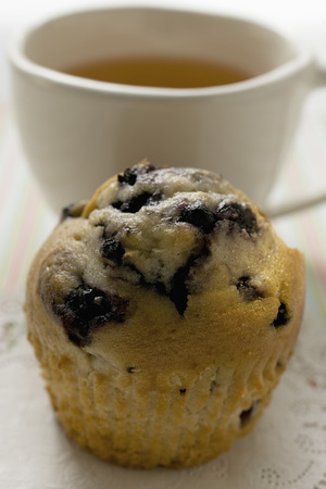blueberry muffin: Blueberry muffin in front of a cup of tea