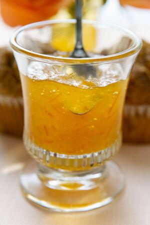 perishable: Orange jelly in a glass