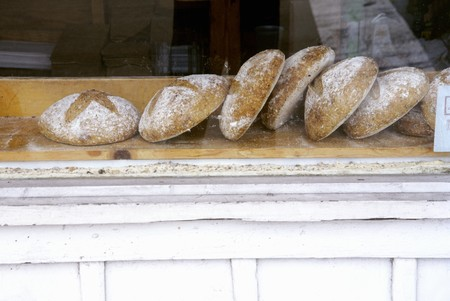 several breads: Loaves of Bread in a Bakery Window
