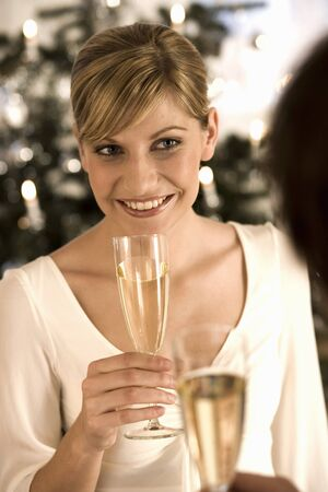 infusing: Young woman about to take a drink of champagne LANG_EVOIMAGES