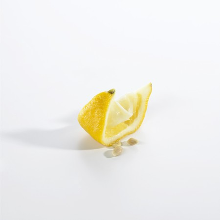 lemon wedge: Squeezed lemon wedge LANG_EVOIMAGES