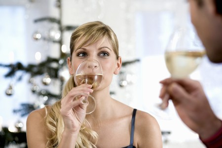 connoisseurs: Young woman drinking white wine