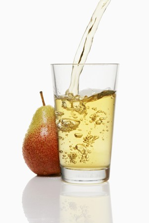 no movement: Pouring pear juice into a glass & pear
