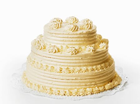 cream cake: A three-tiered cream cake on white background LANG_EVOIMAGES