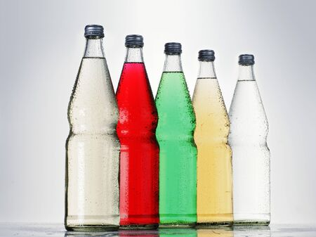 soda pops: Five bottles of different fizzy drinks