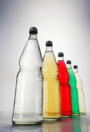 Five bottles of different fizzy drinks