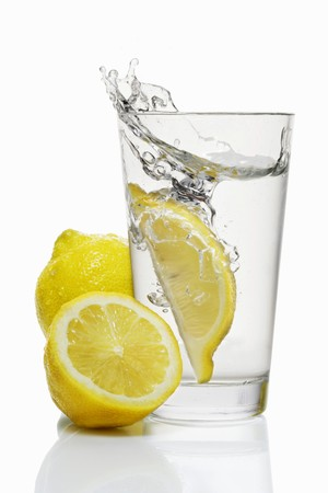 squirted: A wedge of lemon falling into a glass of water