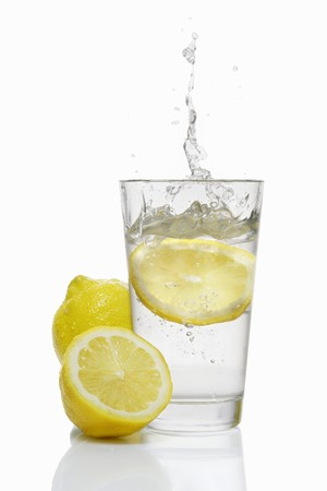 squirted: A slice of lemon falling into a glass of water LANG_EVOIMAGES